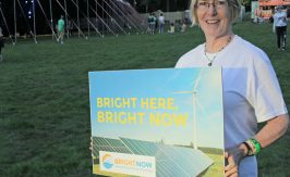 Jean Leston holding Bright Now poster.